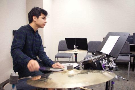 Freshman Luke Belcher plays the drum at practice during SRT.