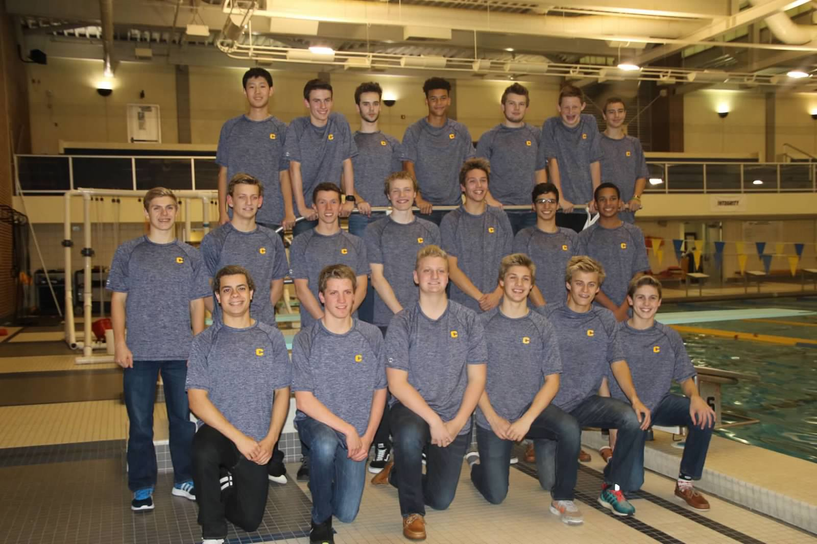 The sophomore swimmers pose for their photo before practice starts. The men's first meet is on Dec. 6.