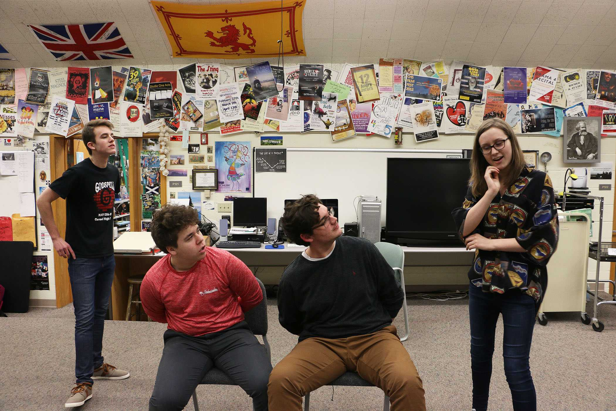 """PATH FINDER: With her fellow ComedySportz participants, junior Sarah Lein  (right) participates in an """"Interrogation"""" activity with junior Eric Bembenek (left) and senior Chuck Burton (center). Lein joined ComedySportz to figure out what path she wants to take."""