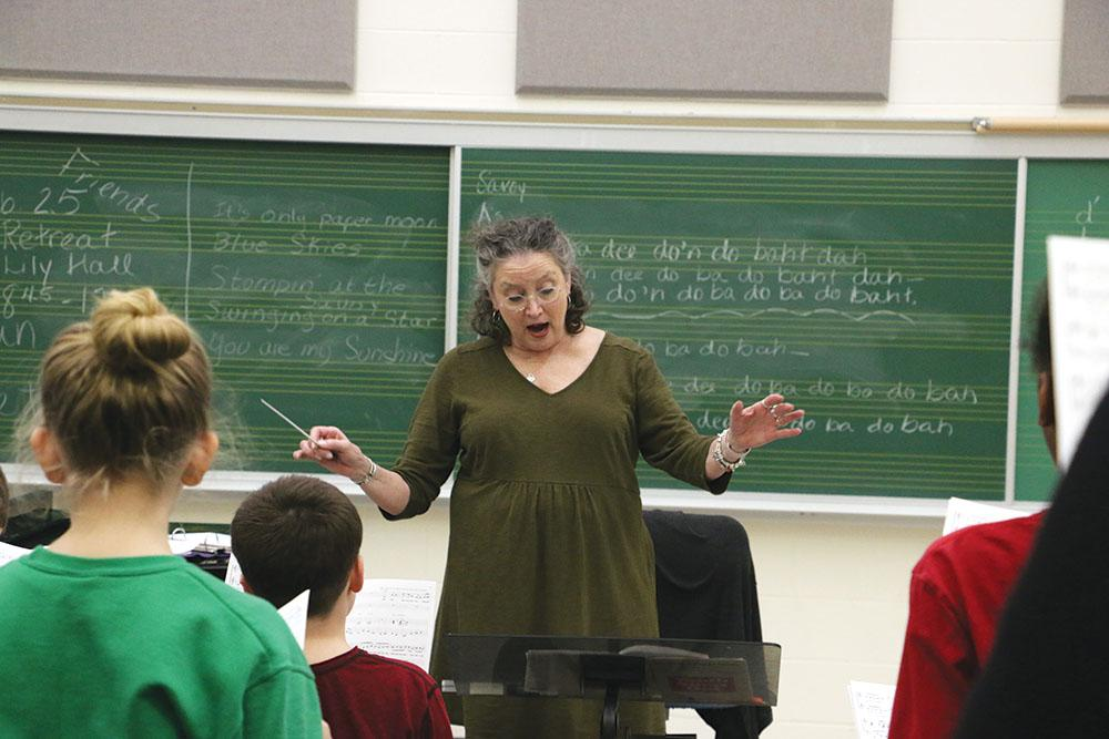 ICC choir director Sarah Hassler leads the choir. Hassler said the grant will be used for outreach.