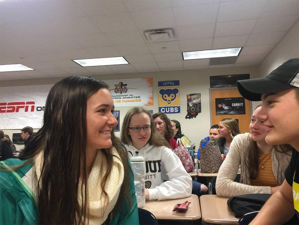 "Maddie Dalton, FCA future leader and junior, sits in a group to lead an activity.""I'm thinking of new things that we can incorporate (next year),"" Dalton said."