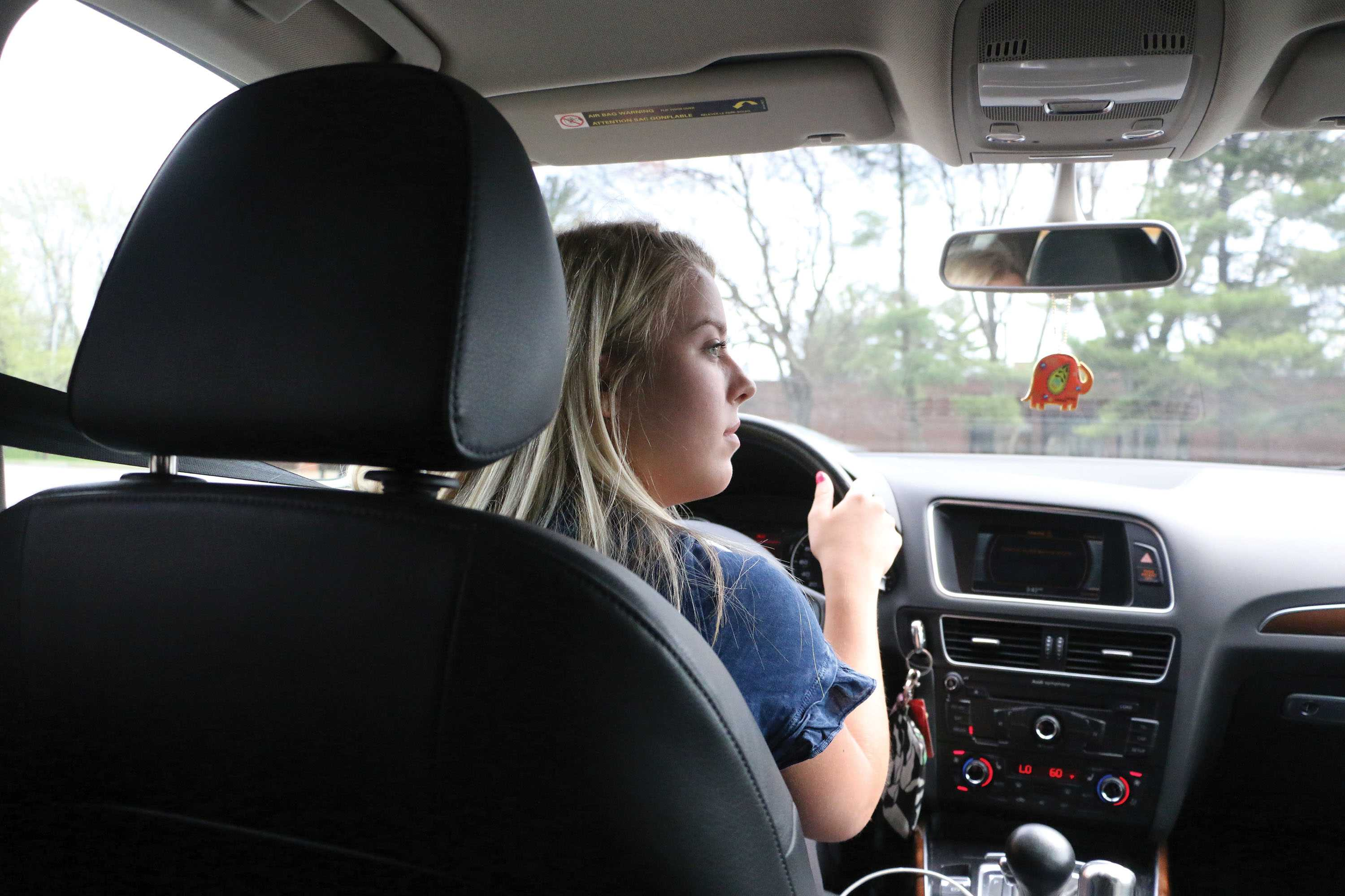 CAREFUL CONDUCTING: Sophomore Lucy Salter waits to make a left turn onto Main Street. Salter was in an accident in a roundabout last January.