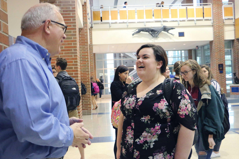 PRINCIPLE OF PRINCIPALS:  Principal John Williams talks to senior Sarah Biette. Student Body President Mike Pitz said it saddens him to see him go, but he appreciates the time and leadership Williams provided.