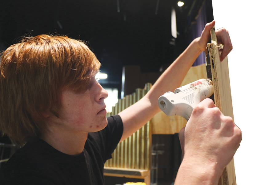 Jack+McDougall%2C+technical+crew+member+and+junior%2C+glues+a+pipe+to+the+prop+organ.+The+organ+is+the+Phantom%27s+instrument+of+choice+in+the+musical.