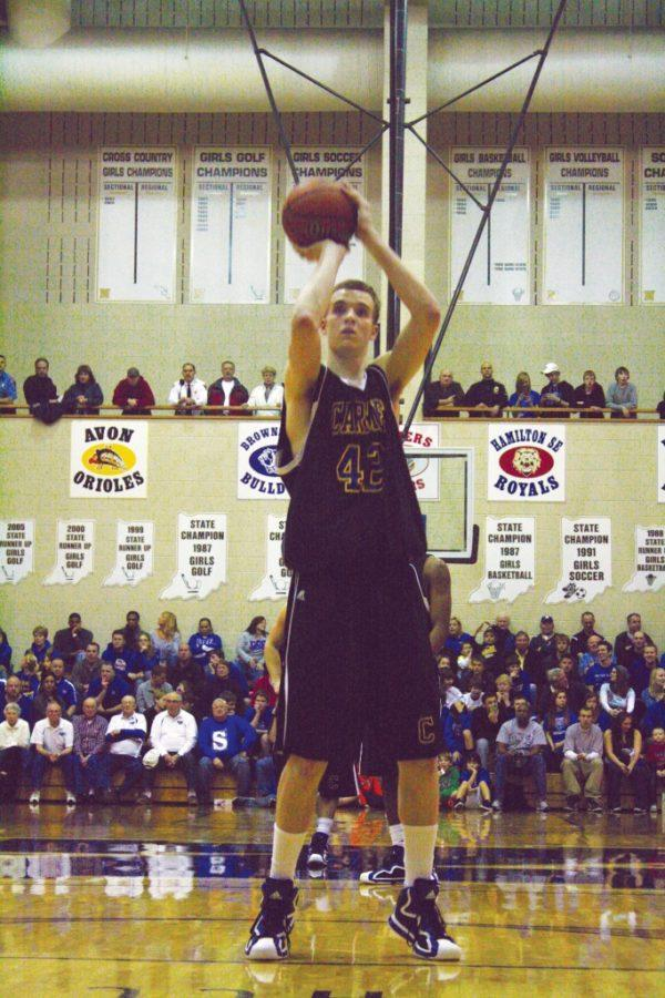 HEAVY+PASSION%3A+Alec+Peterson%2C+basketball+player+and+senior%2C+shoots+a+free-throw+during+Sectional+play.+Peterson+has+signed+to+play+at+Huntington+University%2C+which+is+a+Division+II+program+located+in+northeastern+Indiana.+Peterson+said+he+has+a+good+relationship+with+the+coaching+staff+and+the+other+players.+MARY+BROOKE+JOHNSON+%2F+PHOTO