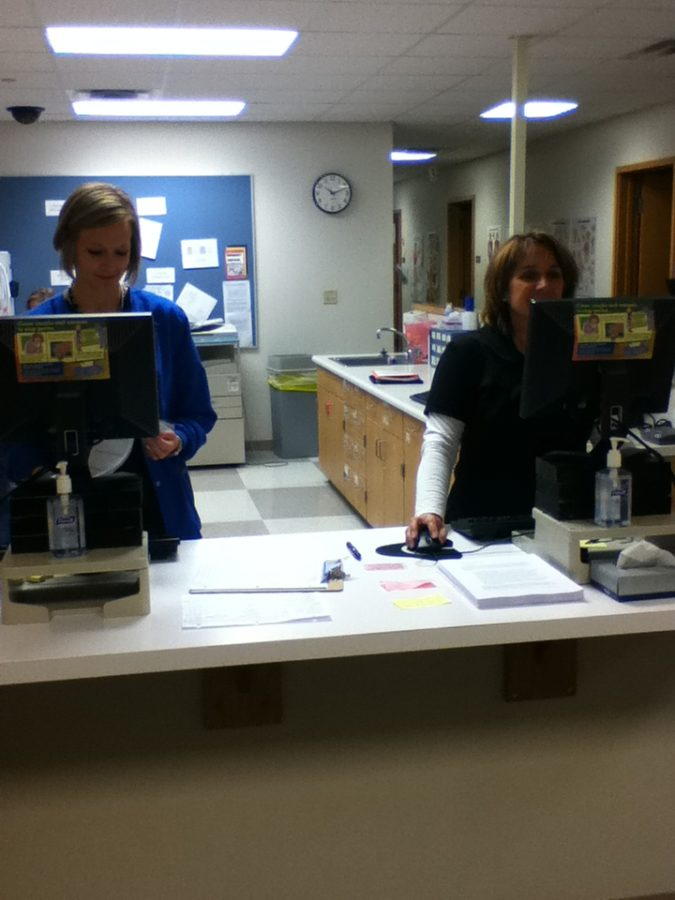 Nurse Carol Gelatt makes sure that students who come into the health center have their medical records updated for the new school year. KAYLA WALKER / PHOTO