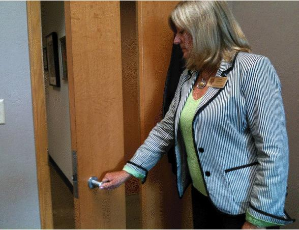 Assistant Principal Ronda Eshleman opens the door to leave her office. Two weeks ago, Eshleman announced that she would step down as assistant principal and leave CHS.