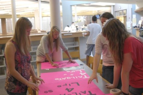 House members senior Hannah Blachly, sophomore Casey Gorin, senior Julie Gaylor, and sophomore Jenna Wiegand (left to right) make posters to promote Tailgate for Life. Tailgate for Life is a House event that will raise money for breast cancer research this year. OMEED MALEKMARZBAN / PHOTO