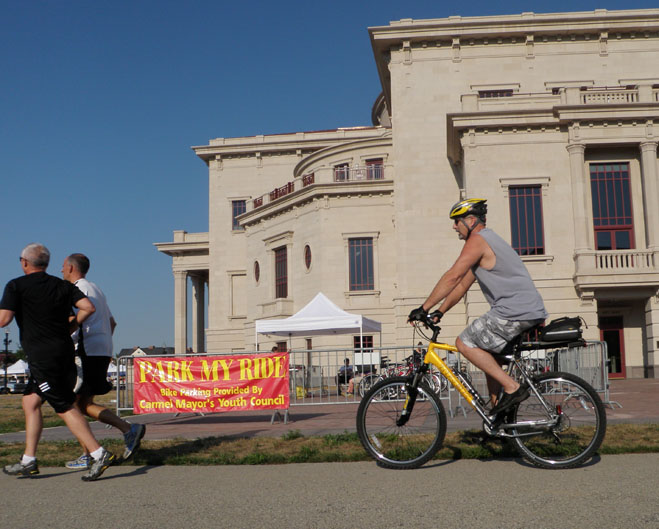 PARK IT: A biker leaves the Farmers' Market after picking up his bike from the Park My Ride. As one of services provided by CMYC, Park My Ride is a free bike parking service hosted every Saturday from 8 to 11 a.m. for anyone visiting the Farmers' Market.  MONICA CHENG / PHOTO