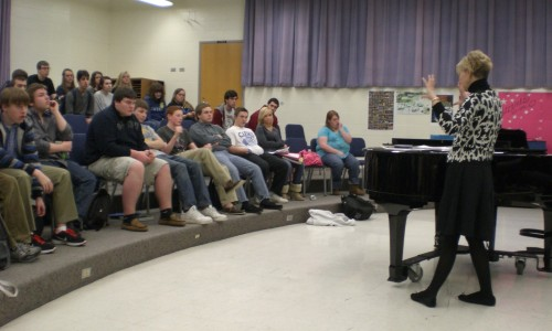 Choir director Diana Gillespie teaches Blue and Gold Singers about the history behind the upcoming musical, Les Misérables, which many choir members will perform in at the end of April. Choir members will audition for next years choir placements between Feb. 2 and March 3. KIM QIAN / PHOTO