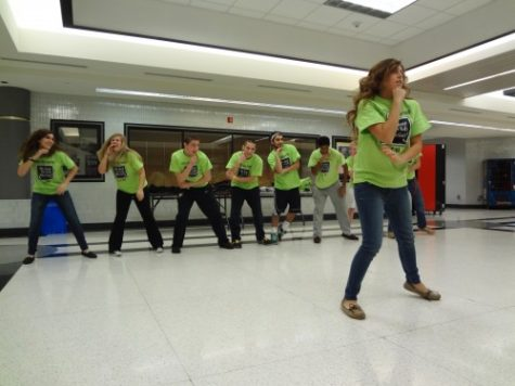 DANCE PHILANTHROPY: Allie McCan, Cabinet member and senior, leads fellow Cabinet members as they practice last year's Dance Marathon line dance for the community focus group on Jan. 5. The group came to CHS to spread philanthropic ideas about volunteering and getting involved in the community, and Dance Marathon is one school group that exemplifies these ideals. MONICA CHENG/PHOTO