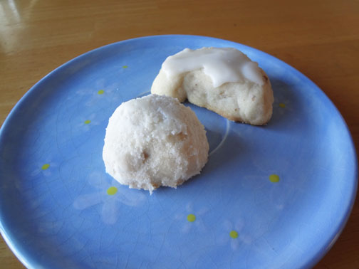 A glimpse of what these snowball cookies look like. I made one snowball-shaped and dipped it in powdered sugar. For the other, I formed a crescent shape and iced it with what is literally powdered sugar mixed with a tiny amount of water.