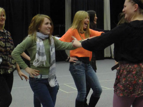 "DEADLY DANCE MOVES: Laura Ellsworth, or Toffee in ""Zombie Prom"" and sophomore, freshman Kristen Barnes and senior Lauren ""Lo"" Odom rehearse after school on Jan. 4. Ellsworth said she enjoys her character, because she can be ""over-the-top."" MIKAELA GEORGE / PHOTO"