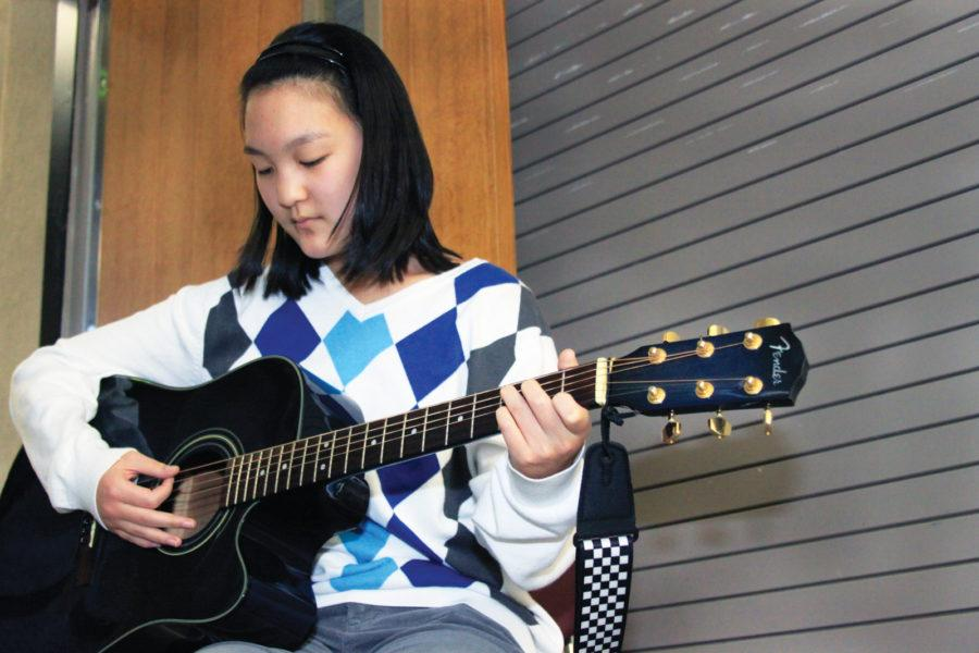 MUSICAL TALENT: Sophomore Rachel Chen plays her guitar and sings her favorite songs by different artists. Chen said she likes to make covers of songs and upload them to her YouTube channel, rchenmusic.