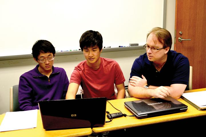 Seniors Lyndon Ji and Youkow Homma work with Dr. Roland Roeder, mentor and assistant professor at IUPUI. Ji leaves CHS to do more advanced outside research on his Gold Days. OMEED MALEKMARZBAN / PHOTO