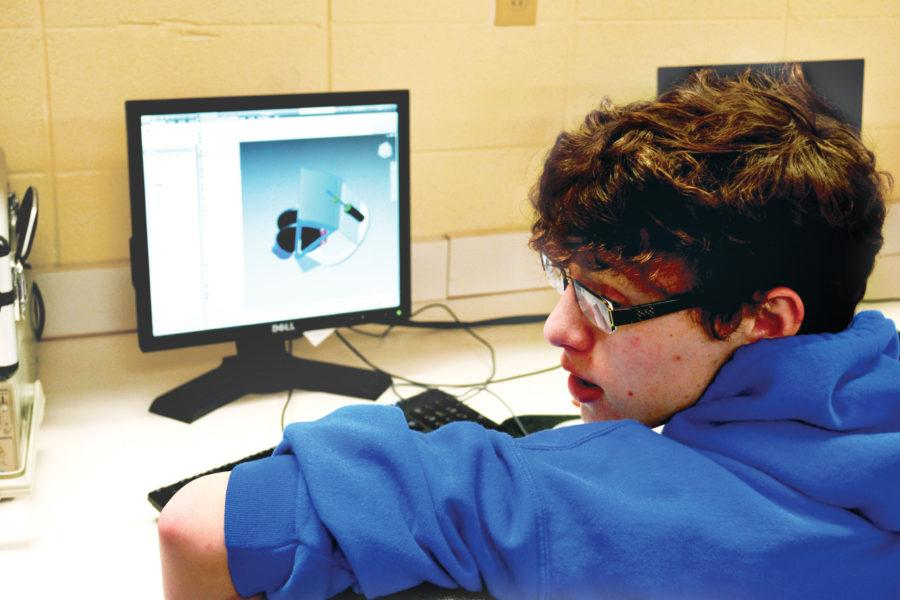 Let Go: Senior Josh Foster explores the computer-aided design software in his Introduction to Engineering Design class. Under the new model, students have the opportunity to learn more by themselves. Omeed Malekmarzban / Photo