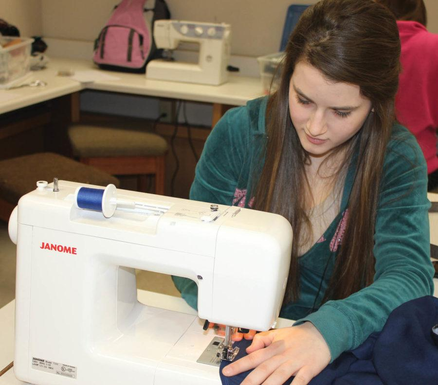 STITCHED UP: Jessica Scherb, Fashion and Textiles 8 student and senior, sews a dress in class on Jan. 5. She has taken the class for four years. JULIE XU / PHOTO