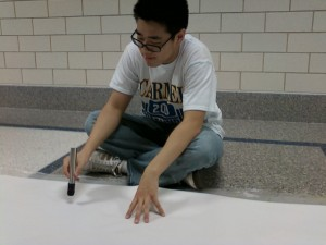 Eric Cui, LifeLines member and junior, decorates a banner for Black History Month. LifeLines is hosting a month-long campaign to promote awareness of Black History. VICTOR XU / PHOTO.