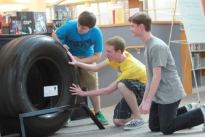 Freshmen A.J. Baldwin, Matt Bear, and Andrew Glesing observe the NASA tire displayed at the media center. CHS received the tire through NASA's Space Shuttle Main Landing Gear Tire Loan Program. The tire will remain at CHS for three years. HENRY ZHU/ PHOTO