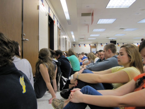 take cover: Students take precautions during the tornado on March 2. Williams said administration has determined the first floor as the safest floor. Kathleen Bertsch / Photo