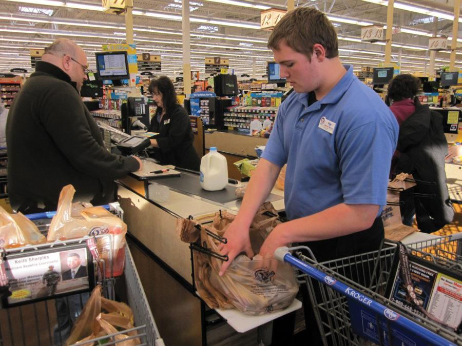 Junior Kyle Tosh works at the Kroger on 146th street. Although the International Union of Operating Engineers Local 150 filed a suit to block the right-to-work law, it was later withdrawn. KATHLEEN BERTSCH / GRAPHIC