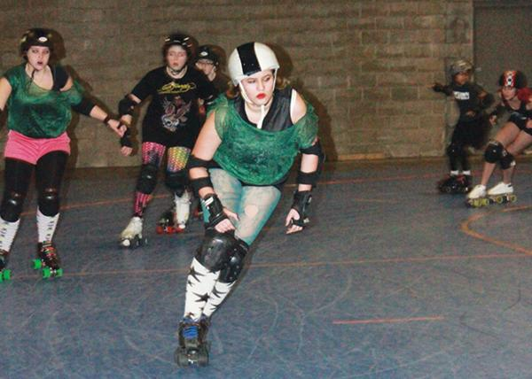 GIRLS ON WHEELS: Junior Kaijah Monson (center) competes in an Indianapolis Junior Roller Derby game. Monson said next year she wants to join the Naptown Roller Girls, an adult roller derby league. HAILEY MEYER / PHOTO