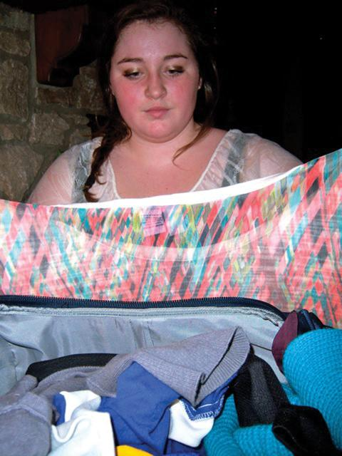 Ready to go: Sophomore Lexi Wheeler prepares for her trip to Mexico by packing her clothes. According to Wheeler, the increasing danger of visiting Mexico won't prevent her from vacationing there. HAILEY MEYER / PHOTO