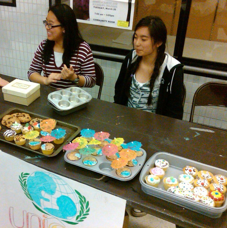 UNICEF club members sell baked goods at a bake sale on Mar. 26. According to club president Stephanie Wu, all proceeds will be donated to the UNICEF organization. ERIC HE / PHOTO