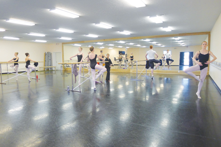 TINY DANCER: Dancer and senior Megan Noonan warms up at the start of a ballet class at her dance studio, the Central Indiana Academy of Dance. Noonan compares her dance classes to her classes at school because they both require respect, memorization and other skills. MIKAELA / PHOTO