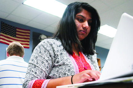 LAST GOOODBYES: Aghilah Nadaraj, vice president of Students for Education and senior, emails the other club officers concerning plans for Houndstock. Nadaraj said she has enjoyed her time as part of the club, and does not look forward to leaving it. HENRY ZHU / PHOTO