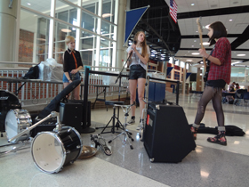 Juniors Anna Brookie, Rachel Peterson and Franci Figueroa, members of the band Spectrum, warm up before their Houndstock audition. Houndstock will be one of House's final events this year. MONICA CHENG / PHOTO