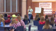 A member of the Cru Club speaks to a group of club members about her faith in a meeting on Sept. 18. JACOB BOTKIN / PHOTO