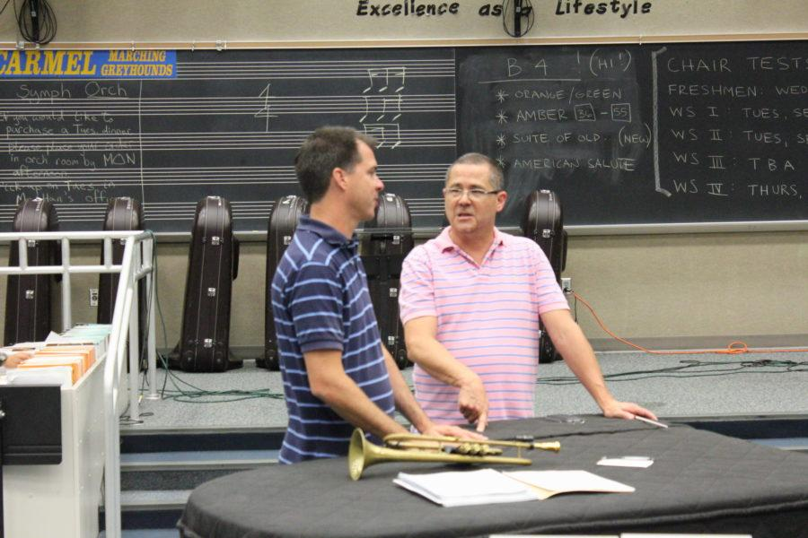 Band teachers Michael Pote and Richard Saucedo discuss in band class. RISE affects classes like band through different evaluations, such as playing exams.