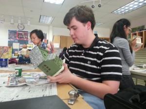 Senior Austin VanScoik puts the finishing touches on his birdhouse that will be a part of the Art Club's Arts Garden project. The Arts Garden is set to be complete by Earth Day 2013 which will be on April 22. HENRY JACKSON / PHOTO