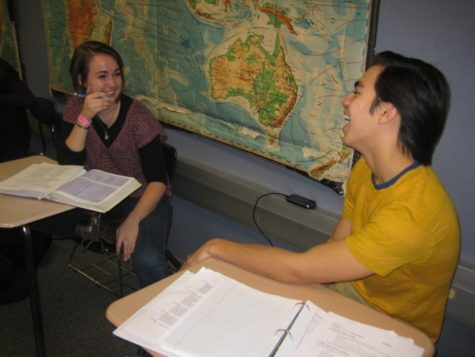 Emma LaPlante and Ian Bossung, Greyhound Connections members and juniors, share a laugh during SRT. Members usually work on homework together while conversing. SHEEN ZHENG / PHOTO