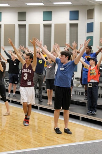 """Members of Ambassadors rehearse after school in preparation for """"Holiday Spectacular,"""" which will take place from Dec. 5 to 8. Ambassadors have attended after school rehearsals every Wednesday from 6 to 9 p.m. since the school year began. CRYSTAL CHEN / PHOTO"""