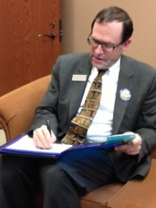 """Superintendent Jeff Swensson looks over his draft of the Performance Qualified School District legislation. The proposed legislation would give the school district """"regulatory relief"""" from state standards. ZUKERMAN / PHOTO"""