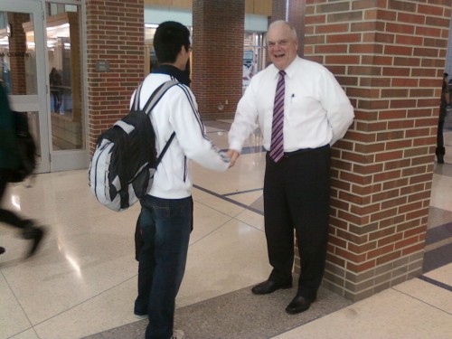 Principal John Williams shakes hands with senior Humphrey Lin during a passing period. Under the new proposed schedule, seniors would have freedoms similar to those of a college student. VICTOR XU / PHOTO