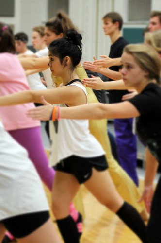 """Junior Sharmaine Ruth Nepomuceno rehearses with Ambassadors in preparation for """"Holiday Spectacular,"""" which will take place from Dec. 5 to 8. All choirs have been preparing for this winter choral concert since the beginning of October. CRYSTAL CHEN / PHOTO"""