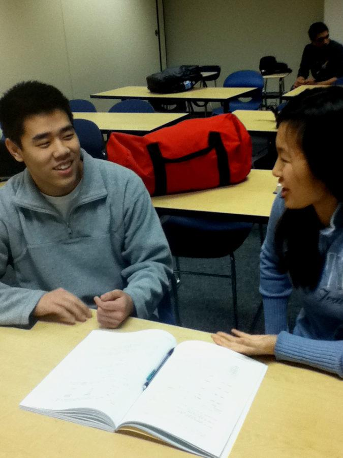 During an officers meeting in SRT, Eric Cui, LifeLines officer and senior, shares his new ideas for February's Black History Month to Nina Sun, vice president and senior. According to Cui and Sun, the fundraising in past years have been low due to conflicts with Dance Marathon fundraising and the two hope for a better outcome this year.