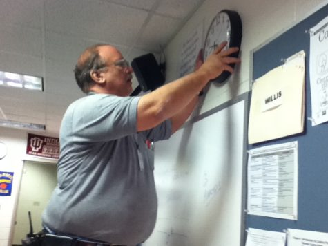 Maintenance staff Ken Badger completes a work order by fixing and returning a clock. The staff  carry out work orders on a daily basis to keep CHS running smoothly. JOSEPH  LEE / PHOTO