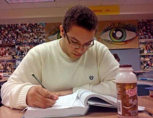 "CALCULATING THE ROUTE TO SUCCESS: Christopher ""Chris"" Jamerson, precalculus student and senior, works on his math homework. Jamerson is noticing an improvement in his grade as well as the grades of his peers."