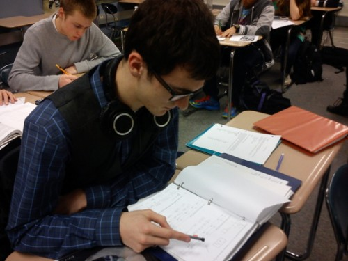 Photo caption…. STEADY LEARNING: Mark SanGiorgio, calculus student and senior, works on his homework. His math class is not rushing to end a chapter as spring break nears, unlike many of his other classes. MATT BARNTHOUSE / PHOTO