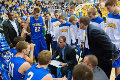 Coach Heady talks to the varsity men's basketball team during a timeout. KYLE CRAWFORD / PHOTO