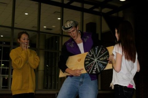 "Grant Goodman, Young Life member and senior, spins the ""Wheel of Misfortune"" during a Young Life Club Meeting. Other meeting activities include singing, raffle prizes and guest speakers. OLIVIA WALKER / PHOTO"