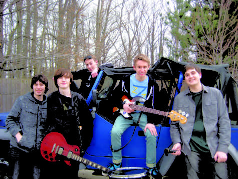 we will rock you: Max Holtman (second from left), member of the band Dead Ringers and junior, stands with his band. Holtman's band can no longer play at Houndstock since House canceled the event. JENNA RUHAYEL PHOTO