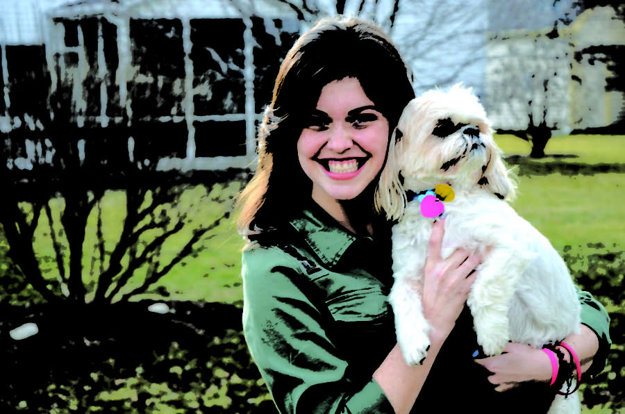 """Dog owner Mallory Marrs poses with her dog, Oscar. Marrs said she is excited for the arrival of a new dog park. """"I think (the new dog park) will be good for the community,"""" Marrs said."""