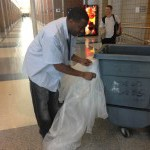 Custodian William Crowder prepares to take the school's trash out. Assistant Principal Doug Bird said the maintenance and custodial departments will be working on preparing the school for spring over break. CLAUDIA HUANG / PHOTO
