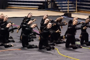 """Members of the guard run through their show, which, according to Makenna Cook, guard member and sophomore, is darker than shows of years past. """"Last year, we were happy angels, and this year we are fierce biker chicks,"""" Cook said.  WALKER / PHOTO"""