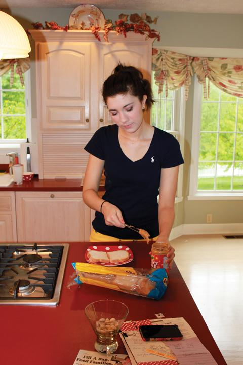 Junior Caroline Payne prepares a gluten-free lunch. According to The New York Times, there has been a recent increase in the popularity  of gluten-free diets despite uncertainty about the diet's health benefits. PHOTO / SUBMITTED PHOTO